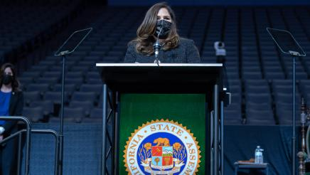 Assemblymember Lisa Calderon standing at the podium