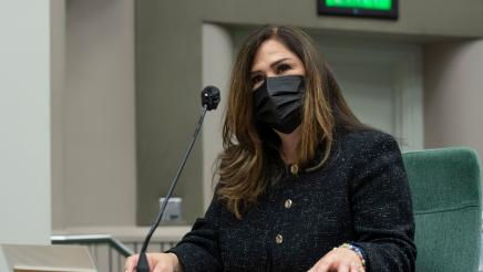 Closeup of Assemblymember Lisa Calderon with a mask on introducing the AB742 - School Supplies for Homeless Children Voluntary Tax Contribution Fund Bill